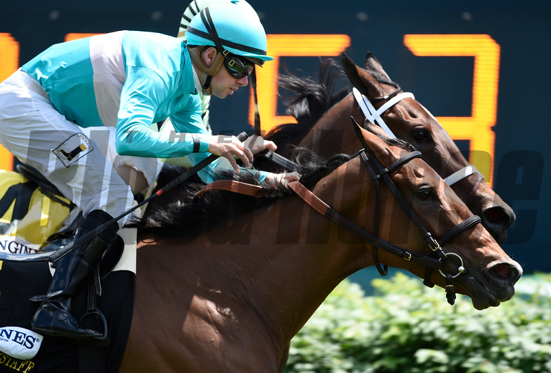Rico Roja with jockey Florent Geroux in the saddle out duels Believe in Bertie to the wire in the 32 running of The Churchill Distaff Turf Mile at May 6, 2017 at Churchill Downs in Louisville, Kentucky.  Photo by Skip Dickstein