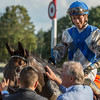 Trainer Bill Mott pat his charge Elate on the neck as jockey Jose Ortiz smiles broadly after winning the 137th running of The Alabama Saturday Aug. 19, 2017 at the Saratoga Race Course in Saratoga Springs, N.Y.  (Skip Dickstein
