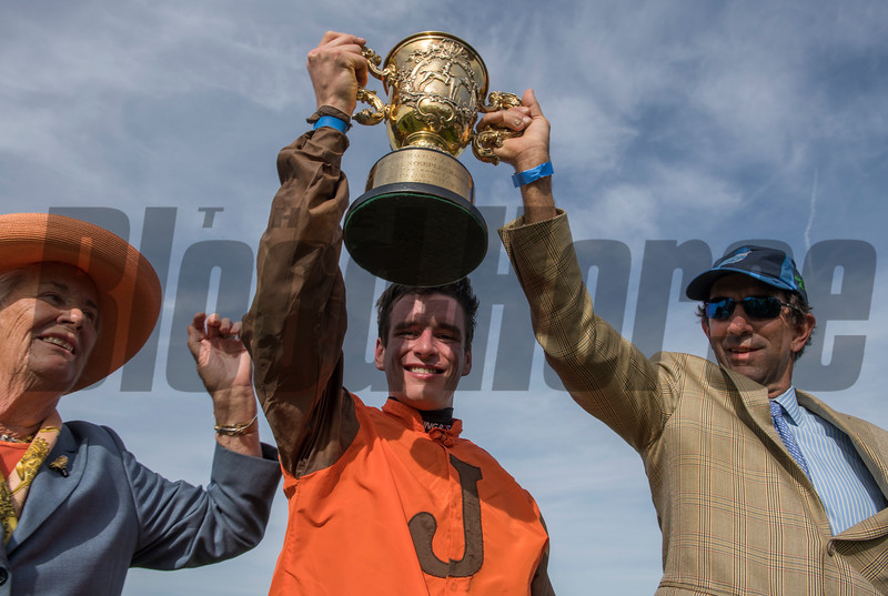Owner Mrs. S.K. Johnston with her jockey Danny Mullins and trainer Jack Fisher hold there winner's trophy aloft after winning the Grand National Steeplechase race at Far Hills Race Course  Oct. 21, 2017 in Far Hills, N.J.  Photo by Skip Dickstein.