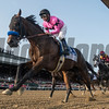 West Coast ridden by jockey Mike Smith lead wire to wire as he passes the clubhouse for the first time on the way to the win in the 148th running of The Travers Stakes at the Saratoga Race Course in Saratoga Springs, N.Y.  (Skip Dickstein