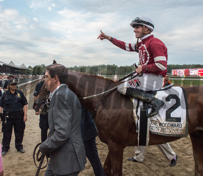Owner Ron Winchell, right, takes Gun Runner and jockey Florent Geroux to the winner's circle after he win the 64th running of The Woodward presented by NYRA Bets Saturday Sept. 1, 2017 at the Saratoga Race Course in Saratoga Springs, N.Y. (Skip Dickstein