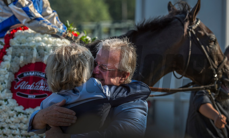 Trainer Bill Mott hugs owner Adele Dilschneider after Elate won the 137th running of The Alabama Saturday Aug. 19, 2017 at the Saratoga Race Course in Saratoga Springs, N.Y.  (Skip Dickstein