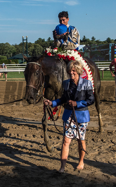Elate with jockey Jose Ortiz lis lead to the winner's circle by owner Adele Dilschneider after winning the 137th running of The Alabama Saturday Aug. 19, 2017 at the Saratoga Race Course in Saratoga Springs, N.Y.  (Skip Dickstein/