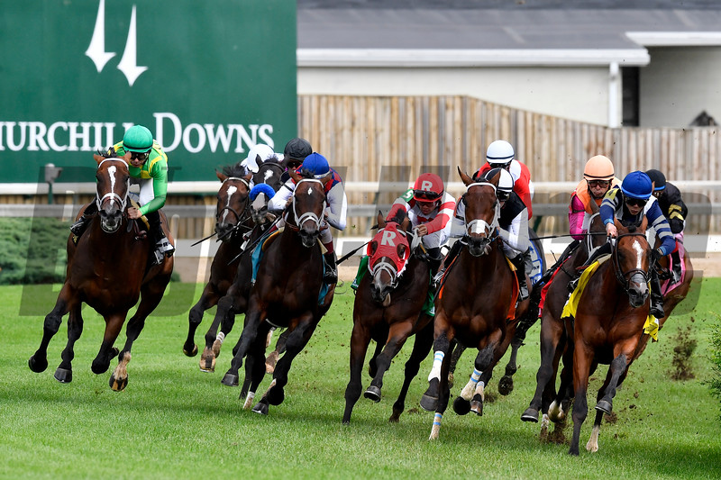 Arklow (far outside) with Mike Smith aboard, rounds the field, turning for the finish in the 26th running of The American Turf (G2).