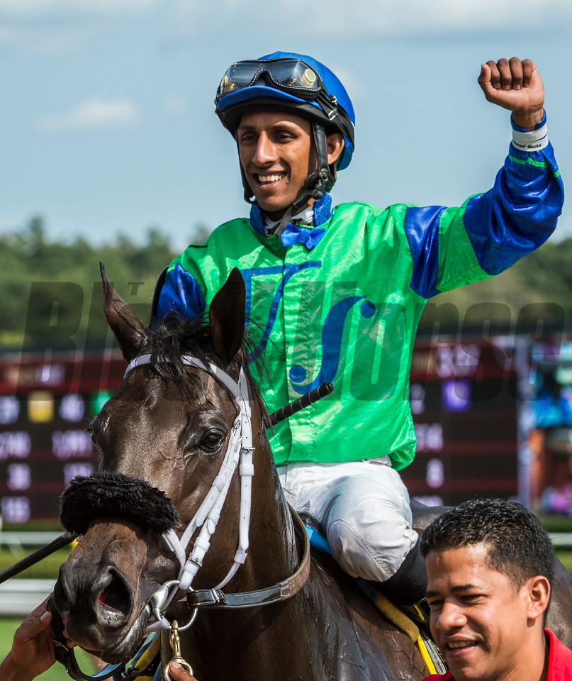 "By the Moon""s jockey Rajiv Maragh puts his fist in the air after winning the 39th running of The Ketel One Ballerina at the Saratoga Race Course in Saratoga Springs, N.Y.  (Skip Dickstein"