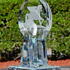The trophy is revealed in the winner's circle by designer Mark Raynes Roberts, 2017 Pegasus World Cup