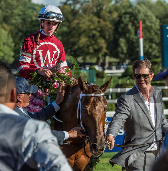 Owner Ron Wihchell leads his horse Gun Runner and jockey Forent Geroux to the winner's circle after he won the 90th running of The Whitney Stakes at the Saratoga Race Course  Saturday Aug. 5, 2017 in Saratoga Springs, N.Y.  (Skip Dickstein