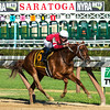 Gun Runner with jockey Florent Geroux carries a little extra weight, Cautious Giant's shoe hanging from his tail as he wins the 90th running of The Whitney at the Saratoga Race Course  Saturday Aug. 5, 2017 in Saratoga Springs, N.Y.  (Skip Dickstein/