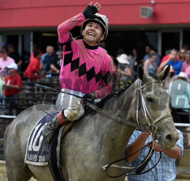 Jockey Nik Juarez is jubilant after winning the 92nd running of The Black-Eyed Susan on Actress May 19, 2017 at Pimlico Race Course in Baltimore, MD.  Photo by Skip Dickstein