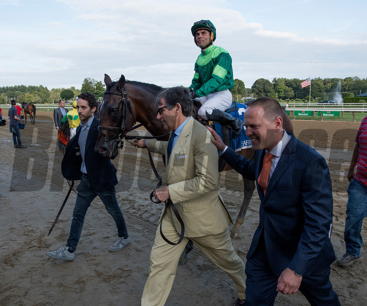 Chris and Peter Brant with an assist from record breaking trainer Chad Brown lead Raging Bull to the winner's circle after winning the Saranac  at the Saratoga Race Course Saturday Sept. 1, 2018  in Saratoga Springs, N.Y.  Photo: Skip Dickstein