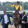Uriah St. Lewis Jr. and Senior leads Discreet Lover with Manny Franco to the winner's circle after winning the 100th running of The Jockey Club Gold Cup at Belmont Park Saturday Sept. 29, 2018 in Elmont, N.Y.  Photo by Skip Dickstein
