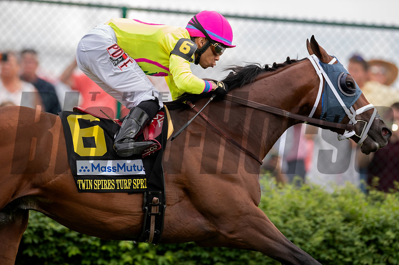 WORLD OF TROUBLE wins the Turf Sprint at Churchill Downs on May 3rd, 2019, jockey Manuel Franco up