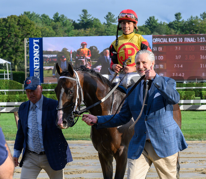 Terry Green of Jackpot Stables, right leads Basin and jockey Jose Ortiz to the winner's circle after winning the 115th running of The Runhappy Hopeful at the Saratoga Race Course Monday Sept. 2, 2019 in Saratoga Springs, N.Y.  Photo  by Skip Dickstein