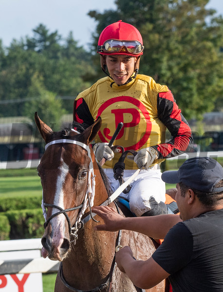 Jose Ortiz who has been crowned leading jockey for the 2019 meeting is all smiles after winning the 115th running of The Runhappy Hopeful on Basin at the Saratoga Race Course Monday Sept. 2, 2019 in Saratoga Springs, N.Y.  Photo  by Skip Dickstein