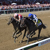 Midnight Bisou wins the 2019 Personal Ensign Stakes at Saratoga<br /> Coglianese Photos/Chelsea Durand