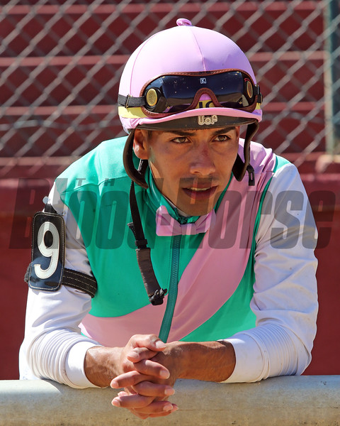 Jose Ortiz watches the replay of The Just A Kiss Stakes at Delaware Park on July 13, 2019. Photo By: Chad B. Harmon