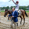 Jockey Thomas Garner is jubilant after winning the 78th running of The New York Turf Writers Cup on Winston C as they are lead to the winner's circle by owner Ed Swyer Thursday Aug. 22, 2019 at the Saratoga Race Course in Saratoga Springs, N.Y.  Photo by Skip Dickstein