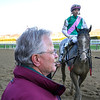 Trainer Bill Mott smiles as he waits for Tacitus and jockey Jose Ortiz to return to the winner's circle after winning the Wood Memorial at Aqueduct Saturday, April 6, 2019. Photo: Skip Dickstein