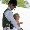 Keeneland outrider Colby Lavergne with his son Cooper, 15 months on April 24, 2019 in Lexington,  Ky.