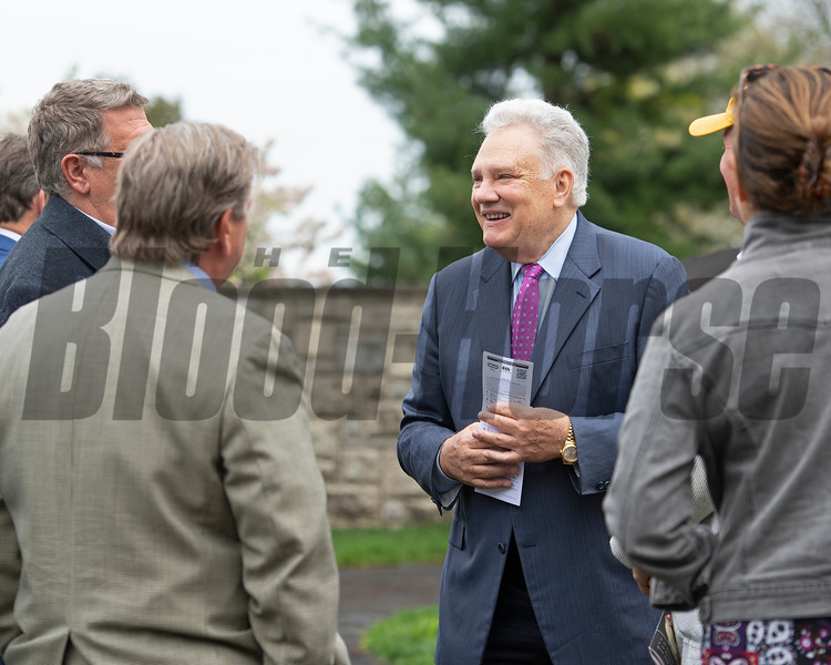 Tom Hammond, second right, with trainer Dale Romans, left, and others in saddling area for Dabo at Keeneland on April 12, 2019 in Lexington,  Ky.