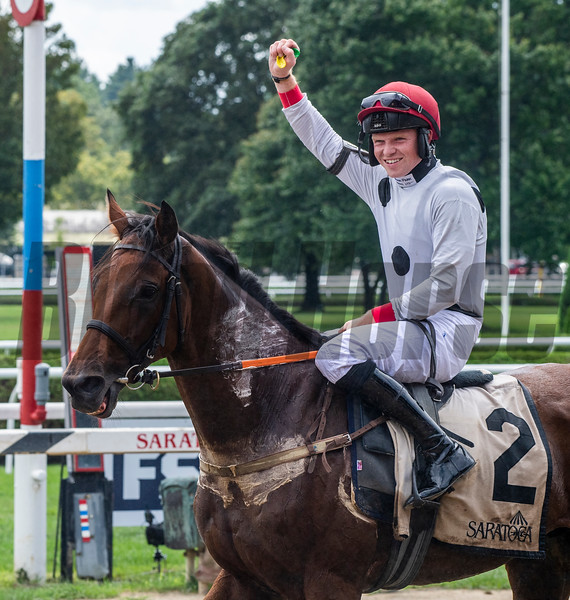 Jockey Thomas Garner is jubilant after winning the 78th running of The New York Turf Writers Cup on Winston C Thursday Aug. 22, 2019 at the Saratoga Race Course in Saratoga Springs, N.Y.  Photo by Skip Dickstein