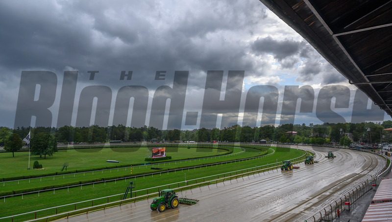 Track crews work to restore the main track to race readiness after rains interrupted racing for approximately 43 minutes Wednesday August 21, 2019 at the Saratoga Race Course in Saratoga Springs, N.Y.  Photo by Skip Dickstein