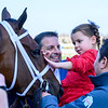 Two year old Gioia Repole gives Always Shopping a pat on the nose as her proud papa and owner Mike Repole watches after winning the 124th running of The Gazelle at Aqueduct Race Track Saturday April 6, 2019 in Ozone Park, N.Y.