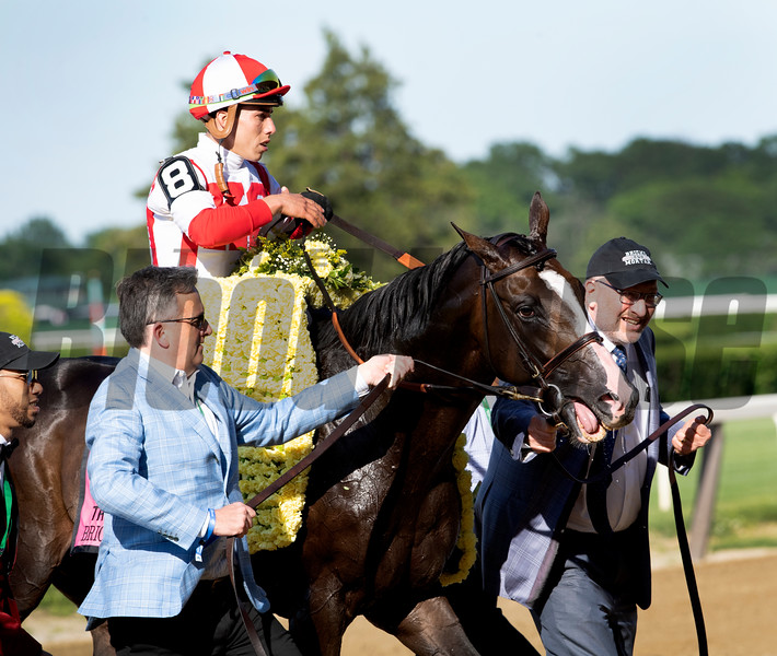 Co-owners Bill Lawrence and Seth Klarman lead Bricks and Mortar with jockey Irad Ortiz Jr.to the winner's circle after the 111th running of The Manhattan Saturday June 8, 2019 at Belmont Park in Elmont, N.Y.   Photo by Skip Dickstein