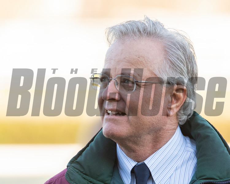 Trainer Bill Mott smiles as he waits for Tacitus and jockey Jose Ortiz to return to the winner's circle after winning the 95th running of The Wood Memorial at Aqueduct Race Track April 6, 2019 in Ozone Park, N.Y.  Photo by Skip Dickstein