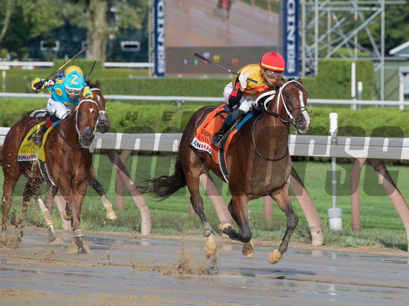 Basin with Jose Ortiz who has been crowned leading jockey for the 2019 meeting passes the field to win the 115th running of The Runhappy Hopeful at the Saratoga Race Course Monday Sept. 2, 2019 in Saratoga Springs, N.Y.  Photo  by Skip Dickstein