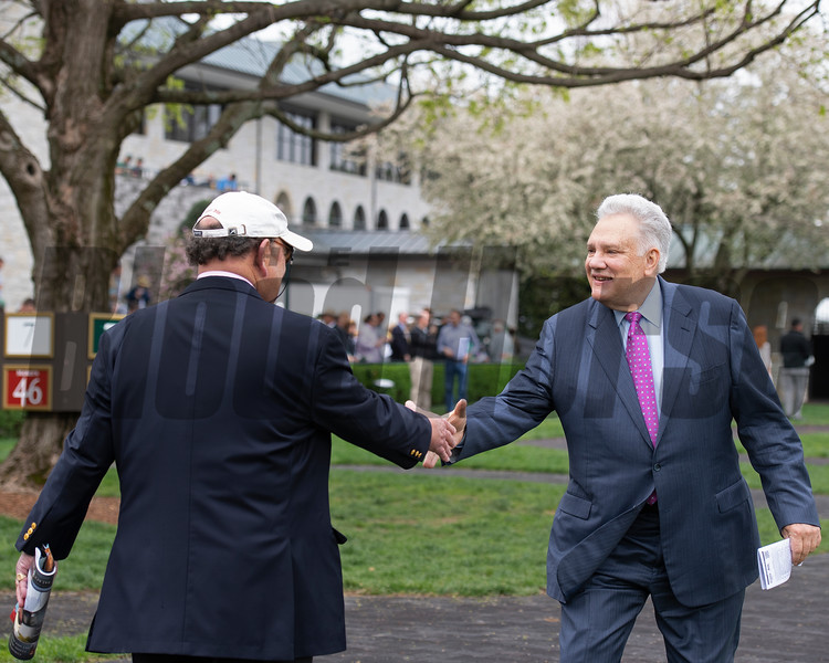 in saddling area shaking hands with Shack Parrish (left). Tom Hammond at Keeneland on April 12, 2019 in Lexington,  Ky.