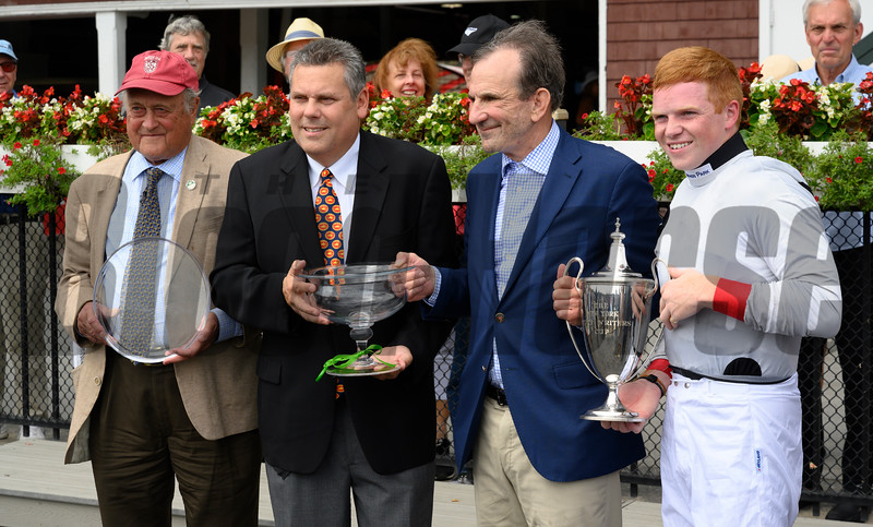 Trainer Jonathan Shepard, left David Grening, president of the NY Turf Writers, owner Ed Slyer and Jockey Thomas Garner in the winner's circle after winning the 78th running of The New York Turf Writers Cup with Winston C  Thursday Aug. 22, 2019 at the Saratoga Race Course in Saratoga Springs, N.Y.  Photo by Skip Dickstein