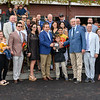 Connections of Basin, Terry Green of Jackpot Stables receives the winner's trophy from NYRA's Tony Olivetti after winning the 115th running of The Runhappy Hopeful on Basin at the Saratoga Race Course Monday Sept. 2, 2019 in Saratoga Springs, N.Y.  Photo  by Skip Dickstein
