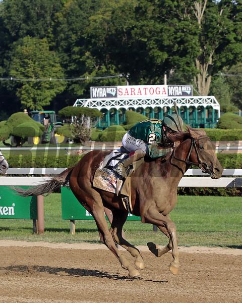 Code of Honor with John Velazquez win the 150th Running of The Travers (GI) at Saratoga on August 24, 2019. Photo By: Chad B. Harmon