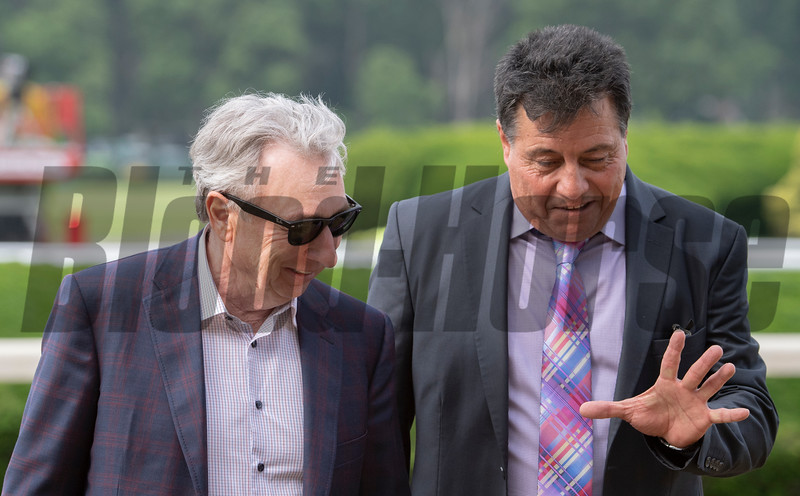 Fore Left's owner Paul Reddam, left speaks with trainer Doug O'Neil's assistant Leandro Mora after winning the 122nd running of The Tremont with jockey Mario Gutierrez at Belmont Park in Elmont, N.Y. June 7, 2019.  Photo by Skip Dickstein