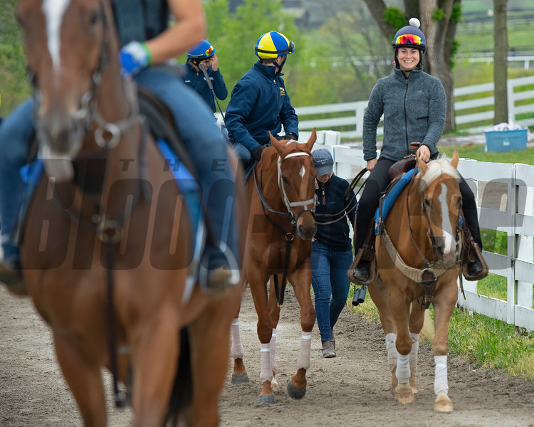 Caption: Monomoy Girl with Florent Geroux is ponied to the track with the Brad Cox string going to the track. Liz Crow walks behind MG and the pony. <br /> Keeneland scenes and horses on April 25, 2020 Keeneland in Lexington, KY.