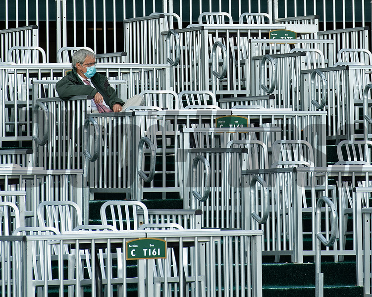 Lone spectator in the temporary stands.<br /> Opening day of the Keeneland fall meeting on October 2, 2020.
