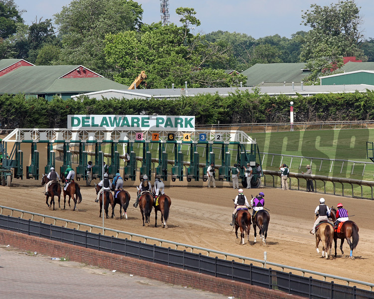 The post parade for the 83rd Running of the Delaware Handicap (GII) with more benches than fans at Delaware Park on July 11, 2020. Photo By: Chad B. Harmon