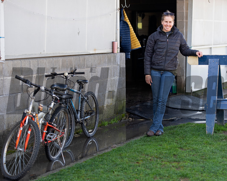 Caption: Kelly Wheeler, exercise rider and assistant trainer to Eddie Kenneally outside of Rice Road barn<br /> Behind the Scenes at Keeneland during Covid19 virus and the people, horses, and essentials needed to take care of race horses on April 2, 2020 Keeneland in Lexington, KY.