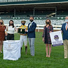 (L-R): unknown part of training team, Andie Biancone, Florent Geroux, Chapman Hopkins, Sarah Reeves, and Drew Fleming. Diamond Oops with Florent Geroux wins the Stoll Kenos Ogden Phoenix (G2) at Keeneland.<br /> Opening day of the Keeneland fall meeting on October 2, 2020.
