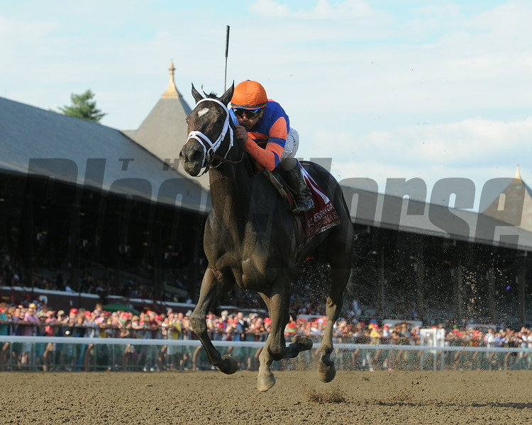 Repole Stable's Stopchargingmaria took over rounding the far turn and drew off to an impressive five-length victory over Unbridled Forever in the Coaching Club American Oaks (gr. I)  at Saratoga Race Course July 20, 2014.<br /> Photo by: Adam Coglianese/NYRA