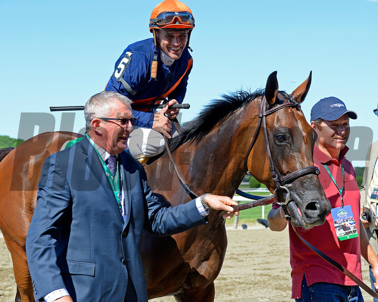 Caption: Trainer Brian Lynch, left, walks in with horse. Coffee Clique with Javier Castellano wins the Longines Just a Game (gr. I)<br /> Belmont Stakes day on June 7, 2014, at Belmont Park in Elmont, N.Y.<br /> 8-JustAGame1 image709<br /> Photo by Anne M. Eberhardt