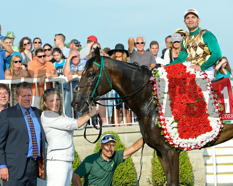Trainer Ed Graham with horse.<br /> Hardest Core with Eriluis Vaz wins the ARlington Million. Aug. 16, 2014<br /> photo by Anne M. Eberhardt