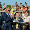 Caption: Mike Ditka, presenter left, with Andrew Bentley and his parents, Mr. and Mrs. Greg Bentley.<br /> Hardest Core with Eriluis Vaz wins the ARlington Million. Aug. 16, 2014<br /> photo by Anne M. Eberhardt