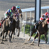 Rosie Napravnik aboard Vicar's In Trouble, right, heads into the Fair Grounds stretch to go on and win the Louisiana Derby (GrII) Saturday, March 29, 2014. Owned by Kenneth and Sarah Ramsey, the 3-year old colt ran the 1 1/8 miles in 1:50.77. Intense Holiday finished 2nd and Commanding Curve was 3rd.<br /> Photo By Alexander Barkoff