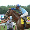 V. E. Day wins the 2014 Travers Stakes at Saratoga.<br /> Coglianese Photos/Adam Mooshian