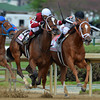 Rose Napravnik on Untapable in the 140th Longines Kentucky Oaks at Churchill Downs.<br /> Courtney V. Bearse Photo