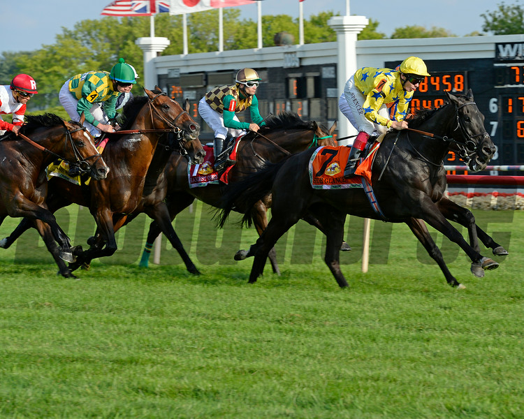 Caption: First time by, with Side Glance in lead.<br /> Hardest Core with Eriluis Vaz wins the ARlington Million. Aug. 16, 2014<br /> photo by Anne M. Eberhardt
