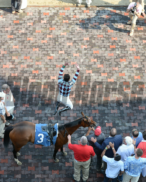 Frankie Dettori celebrates his first win at Saratoga aboard Aventure Love on July 18, 2014.<br /> Coglianese Photos/Susie Raisher