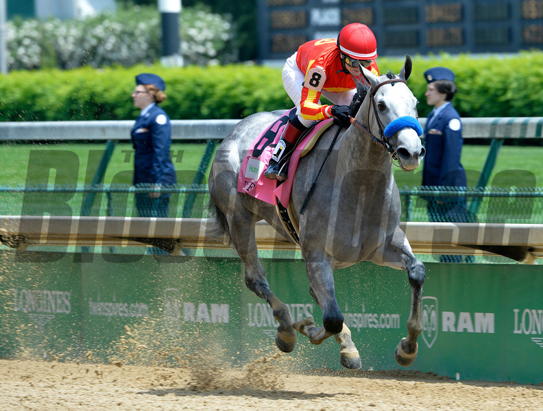 Jockey Rosie Napravnik guides Midnight Lucky to the win in the 28th running of the Humana Distaff Saturday afternoon May 3, 2014 at Churchill Downs in Louisville, Kentucky.   Photo by Skip Dickstein